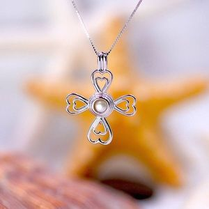 Sterling Silver Cross cage pendant